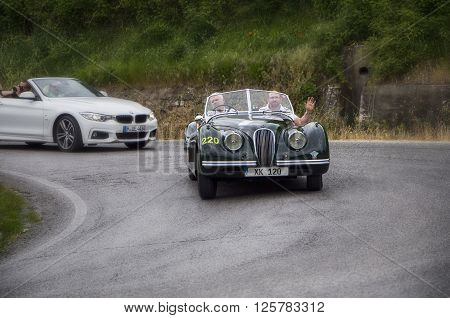 PESARO, ITALY - MAY 15: JAGUAR XK 120 OTS Roadster 1951 on an old racing car in rally Mille Miglia 2015 the famous italian historical race (1927-1957) on May 15 2015