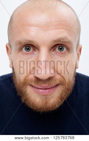 Humor joke caricature. Satisfied man with a ginger beard looks in the frame close-up white background.