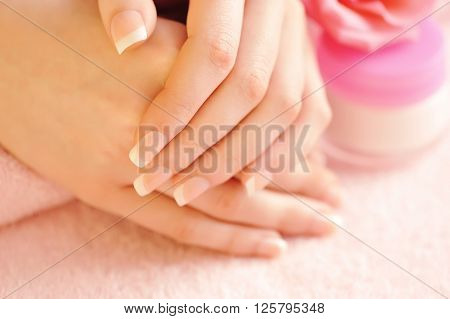 Close-up image of pink french manicure. Concept body care