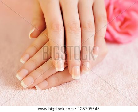 Close up image of pink french manicure
