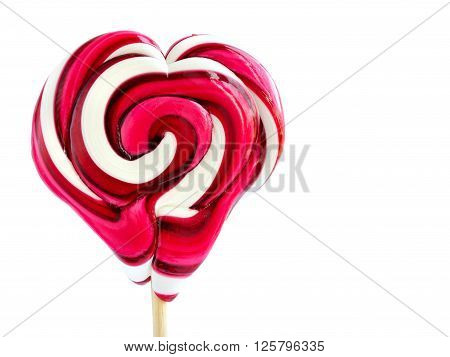 Colourful lollipop in the shape of a heart isolated on white background