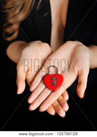 Beautiful Girl With Padlock Heart-shape In Hand