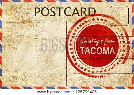 greetings from tacoma, stamped on a postcard