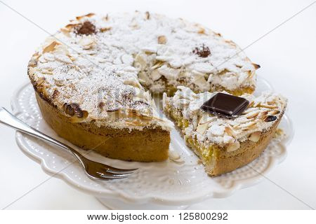 pastry cake with cream covered with almonds and icing sugar