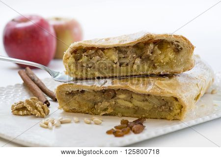 strudel cake cut in half on a tray with ingredients
