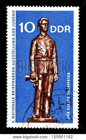 GERMAN DEMOCRATIC REPUBLIC- CIRCA 1970 : Cancelled postage stamp printed by German Democratic Republic, that shows boy holding a trumpet.