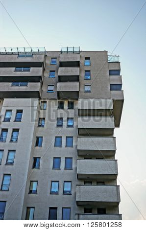 POZNAN POLAND - SEPTEMBER 20 2014: Top of a modern apartment block of the Piastowskie area