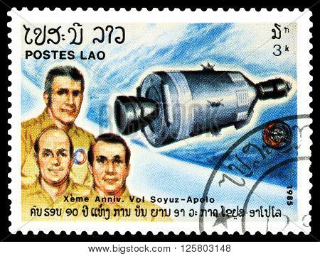 STAVROPOL RUSSIA - MARCH 30 2016: a stamp printed by Laos shows flight the Apollo and Soyuz 10th anniversary circa 1985.