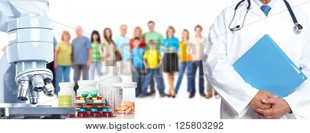 Microscope pills and people group.
