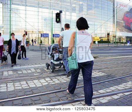 POZNAN POLAND - AUGUST 25 2013: People walking on a zebra crossing on the Glogowska street