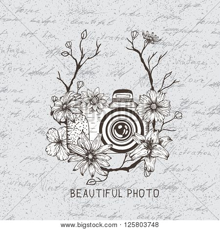 Vintage label with camera and flowers on the paper background.Vintage style