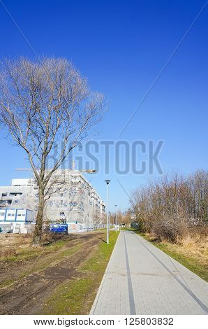 POZNAN POLAND - MARCH 17 2016: New footpath next to a apartment building under construction