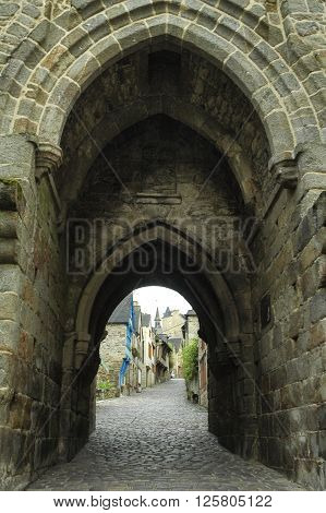 Dinan (Cotes-d'Armor Brittany France): historic buildings at evening. Arch