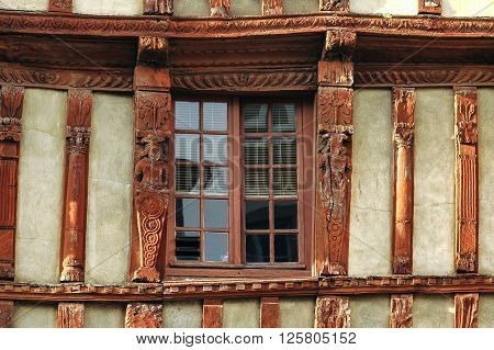 Lannion (Cote-d'Armor Brittany France): facade of old typical half-timbered house: a window