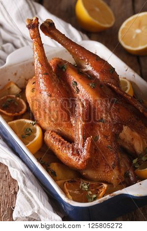 Whole Chicken With Lemon Baked In A Baking Dish Closeup. Vertical