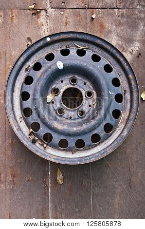 A steel wheel from the front Steel wheel on wood