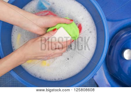 Wash with soap and water in tazike.