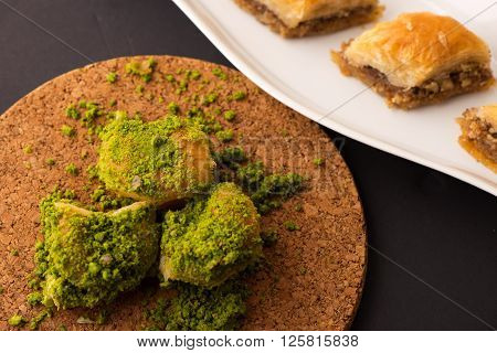 Turkish dessert with special background. Tradional name is Baklava ** Note: Shallow depth of field