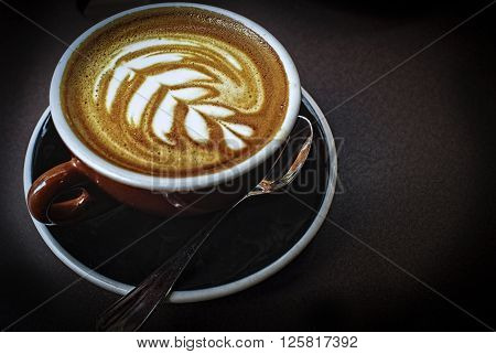 An image of a Coffee cup in coffee shop. ** Note: Shallow depth of field