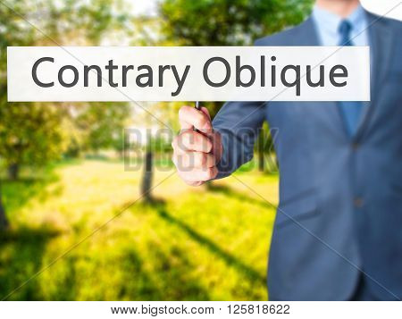 Contrary - Oblique - Businessman Hand Holding Sign
