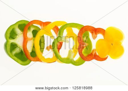 Fresh Bell Pepper Sliced Into Rings, Isolated On White Background.
