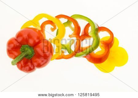 Fresh Bell Pepper Sliced Into Colorful Rings, Isolated On White Background.