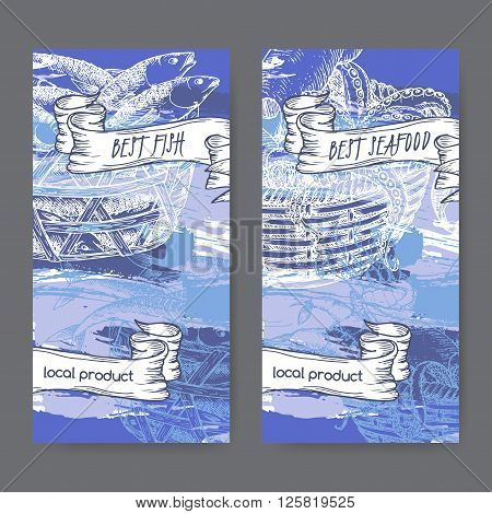 Set of two labels with, fish and seafood baskets on hand painted blue background. Great for markets, fishing, fish processing, canned fish, seafood product label design.