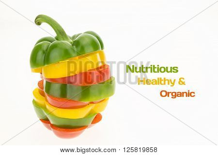 Fresh bell pepper sliced into colorful rings on white background with copy-space for text