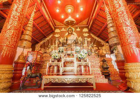 CHIANG RAI THAILAND - NOVEMBER 09 2015: Buddha image in church of Wat Phra Kaew Temple interior.