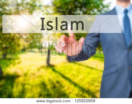 Islam - Businessman Hand Pressing Button On Touch Screen Interface.
