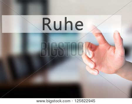 Ruhe (quiet In German) - Hand Pressing A Button On Blurred Background Concept On Visual Screen.