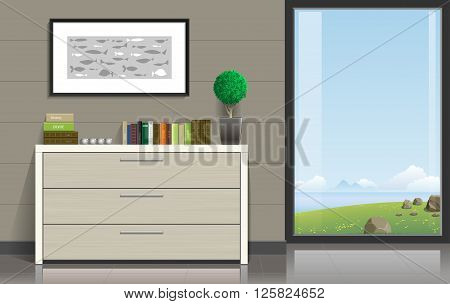 Interior room with a chest of drawers, pictures and a panoramic window overlooking the valley and the ocean