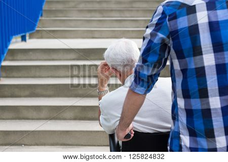 Senior man and dangerous city barriers for wheelchair