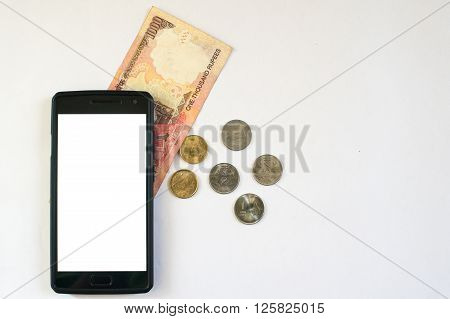 Mobile phone with indian currency set on a white background. Denoting payment through mobile and mobile wallets