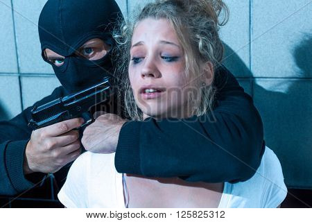 Man Pointing Gun At Girl