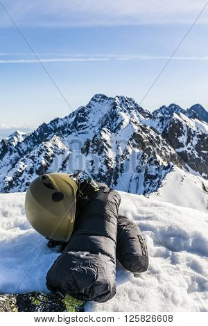 Mittens, Ice Axe, Helmet And Glasses In The Mountains.