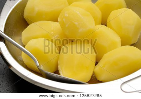 Boiled organic potatoes in a steel bowl