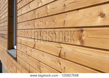 Closeup of finally slatted natural wood on house