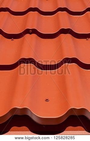 Part of the roof close-up pattern of red metal tile