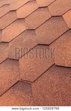Close up of orange shingle roof background