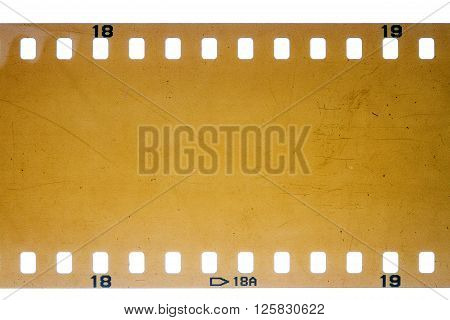 Blank yellow vibrant noisy filmstrip isolated on white background