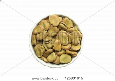 Dried broad beans in a ceramic pot isolated on white background