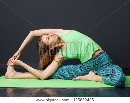 Young Blonde Woman Doing Stretching