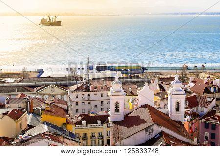 Lisbon coastline with ship at sea at morning