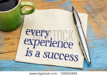 Every experience is a success - handwriting on a napkin with a cup of coffee