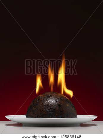 Christmas pudding with flame on a tabletop
