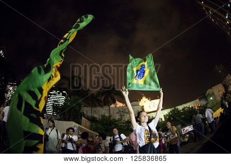 Rio de Janeiro Brasil - March 31 2016: Party workers and social movements are protests in defense of democracy and against the impeachment of President Dilma in the city center in Largo da Carioca