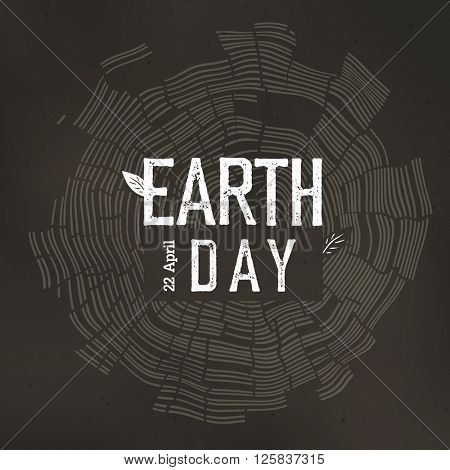 Tree rings and Earth Day logo with date 22 April.