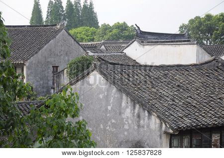 Weathered Chinese buildings within the water town of Tongli located in Jiangsu province China.