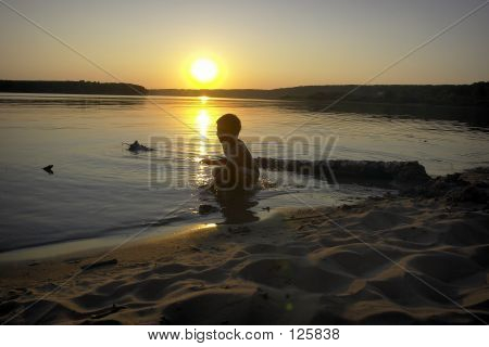 Boy, Sunset And Sea